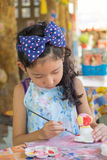 Cute asian girl painting color on the plaster statue. A cute asian girl painting color on the plaster statue Stock Images