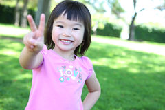 Cute Asian Girl in Park Stock Photos