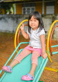 Cute Asian girl play slider. Cute Asian girl play slider at the playground Stock Photos