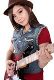 Cute Asian girl playing her guitar, on white background Stock Photography