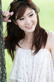 Cute asian girl portrait. A cute asian girl portrait in park Royalty Free Stock Photography