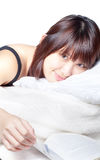 Cute Asian girl reading on bed Stock Image