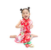 Cute asian girl in red chinese dress with heart in hand isolated Royalty Free Stock Photos