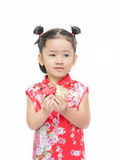 Cute asian girl in red chinese dress with heart in hand Royalty Free Stock Image