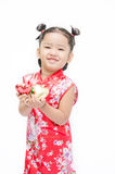 Cute asian girl in red chinese dress with heart in hand Royalty Free Stock Photos