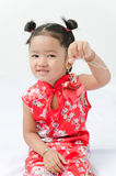Cute asian girl in red chinese dress with heart in hand Royalty Free Stock Images