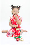 Cute asian girl in red chinese dress Stock Photography