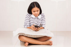 Cute asian girl sitting play mobile stock image