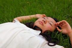 Cute Asian girl sleeping Stock Image