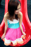 Cute Asian girl on a slide Royalty Free Stock Photos