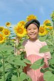 Cute Asian girl smile with sunflower flower stock images