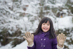Cute asian girl smiling outdoors in snow Royalty Free Stock Image