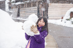 Cute asian girl smiling outdoors in snow Royalty Free Stock Photos