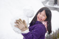 Cute asian girl smiling outdoors in snow Stock Images