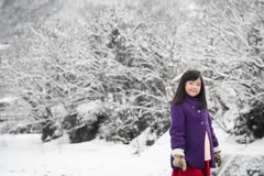 Cute asian girl smiling outdoors in snow Stock Photography