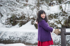 Cute asian girl smiling outdoors in snow Royalty Free Stock Photography