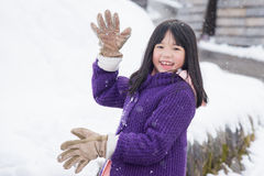 Cute asian girl smiling outdoors in snow Stock Image