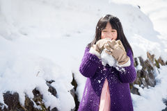 Cute asian girl smiling outdoors in snow Stock Photos