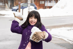 Cute asian girl smiling outdoors in snow Royalty Free Stock Images