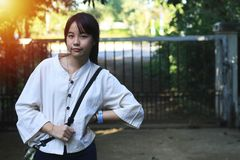 A cute Asian girl is standing in a different position stock image