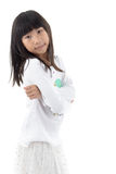 Cute asian girl standing on white background Stock Photo