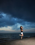 Cute asian girl stay on the beach. Sunset Royalty Free Stock Images
