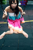 Cute Asian girl on a swing Royalty Free Stock Photos