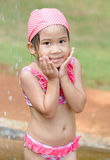 Cute asian girl taking a shower. Cute asian girl taking a shower before to swimming Royalty Free Stock Photos