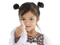 Cute Asian girl with thumb up Stock Photo