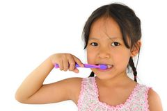 Cute asian girl and toothbrush Stock Photos