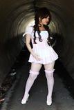 Cute Asian girl. In a tunnel stock photos