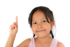 Cute asian girl use forefinger point to top Stock Photo