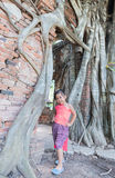 Cute asian girl wear Thai dress at old temple. Royalty Free Stock Photos