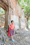 Cute asian girl wear Thai dress at temple location. Stock Image
