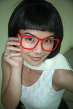 Cute Asian girl wearing glasses Royalty Free Stock Photography