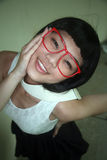 Cute Asian girl wearing glasses Stock Images