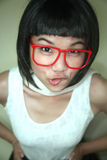 Cute Asian girl wearing glasses Royalty Free Stock Images