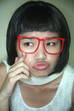 Cute Asian girl wearing glasses Stock Photography
