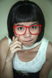 Cute Asian girl wearing glasses Stock Photos