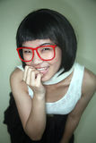Cute Asian girl wearing glasses Royalty Free Stock Image