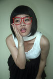 Cute Asian girl wearing glasses Royalty Free Stock Photos