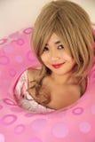 Cute Asian girl. Wearing a lifesaver stock image