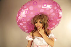 Cute Asian girl. Wearing a lifesaver on her head royalty free stock photo