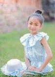 Cute asian girl wearing Thai dress. royalty free stock image