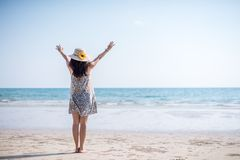 Asian girl on the beach. Cute Asian girl in white dress on the beach thailand alone attractive beautiful blue coast day female happy hat holiday lady lifestyle royalty free stock photos