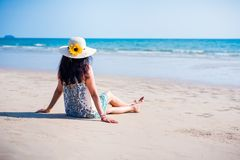 Asian girl on the beach. Cute Asian girl in white dress on the beach thailand alone attractive beautiful blue coast day female happy hat holiday lady lifestyle stock images