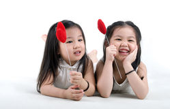 Cute asian girls. Lying on the floor royalty free stock image