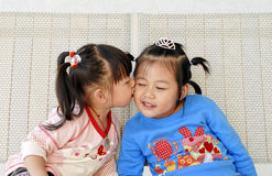 Cute Asian Girls kiss Royalty Free Stock Photo