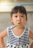 Cute Asian kid brushing teeth Royalty Free Stock Photo