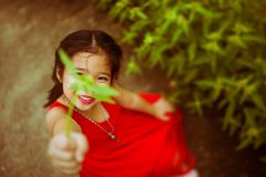 Free Cute Asian Kid Girl Giving Her Flower To You Process In Blue Ton Royalty Free Stock Images - 125610889